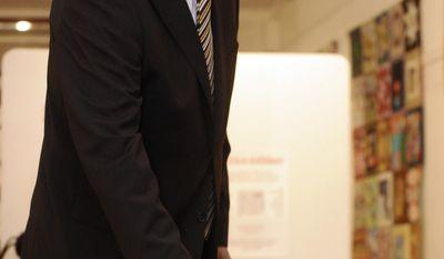 Latvian President Valdis Zatlers casts his ballot at a polling station in Riga, Latvia, on Saturday, Oct. 2, 2010. (AP Photo/Roman Koksarov)