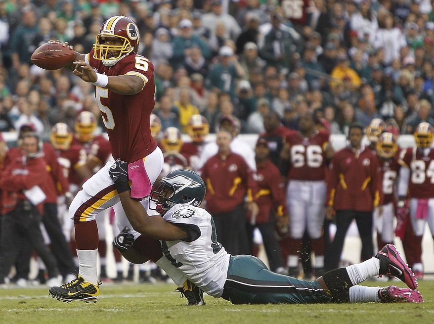 ASSOCIATED PRESS Washington Redskins  quarterback Donovan McNabb drags Philadelphia Eagles defensive end Darryl Tapp with him as he scrambles for yardage during the first half of an NFL football game in Philadelphia, Sunday, Oct. 3, 2010.