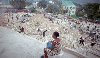 Haitians in Port-au-Prince scavenge for metal Sept. 30 in the rubble of what was the tax collection office. Millions of Haitians still live on the streets amid pies of rubble from Jan. 12's magnitude 7 earthquake. Much promised aid has not materialized. (Associated Press)