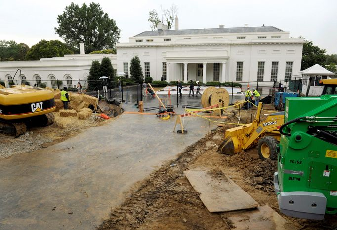 Associated Press Construction continues near the West Wing of the White House on Wednesday. The big question being asked around the White House is, what's that noisy construction really all about?