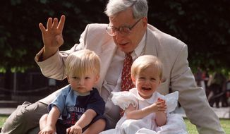 Robert Edwards, the British pioneer of IVF treatment, sits with two of his 'test-tube-babies', Sophie and Jack Emery who celebrate their second birthday in London in this file photo dated Monday July 20, 1998. Dr. Edwards of Britain has won the 2010 Nobel Prize in medicine, it was announced Monday Oct. 4, 2010. (AP Photo/Alastair Grant, File)
