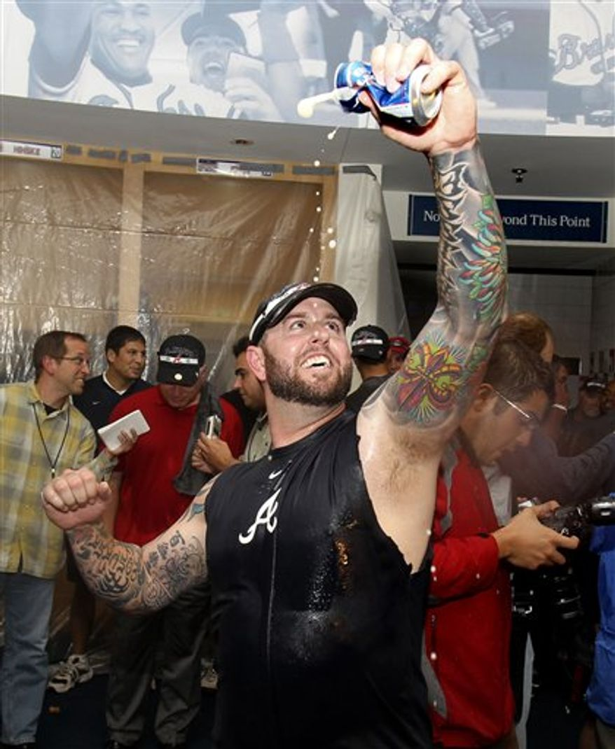 Atlanta Braves relief pitcher Peter Moylan celebrates after the Braves became the NL wild-card team Sunday, Oct. 3, 2010, in Atlanta. The Braves beat the Philadelphia Phillies 7-6; then, the San Francisco Giants beat the San Diego Padres 3-0, giving the Braves the wild card by one game over the Padres. (AP Photo/John Bazemore,pool )