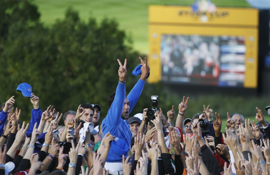 ASSOCIATED PRESS Europe's Edoardo Molinari is lifted by the crowd after Europe wins the Ryder Cup on the final day of the 2010 Ryder Cup golf tournament at the Celtic Manor Resort in Newport, Wales, Monday, Oct. 4, 2010.