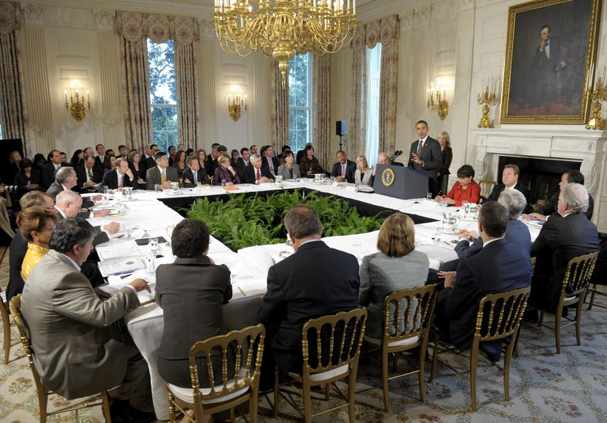 President Obama hosts a meeting of the President's Economic Recovery Advisory Board Monday, Oct. 4, 2010, in the State Dining Room of the White House in Washington. (AP Photo/Susan Walsh)