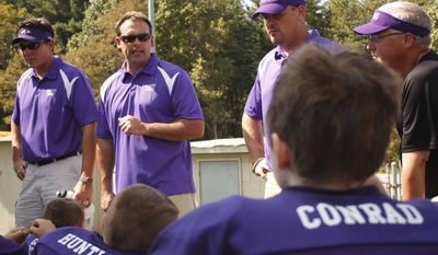 In this photo taken Sept. 18, 2010, U.S. Rep. Heath Shuler  (D-Waynesville), second from left, coaches the Transylvania Jr. Pee Wee Ravens at halftime during the team's first game at Erwin High School in Asheville, N.C. Shuler's son, Navy, 9, also plays on the team. (Associated Press)