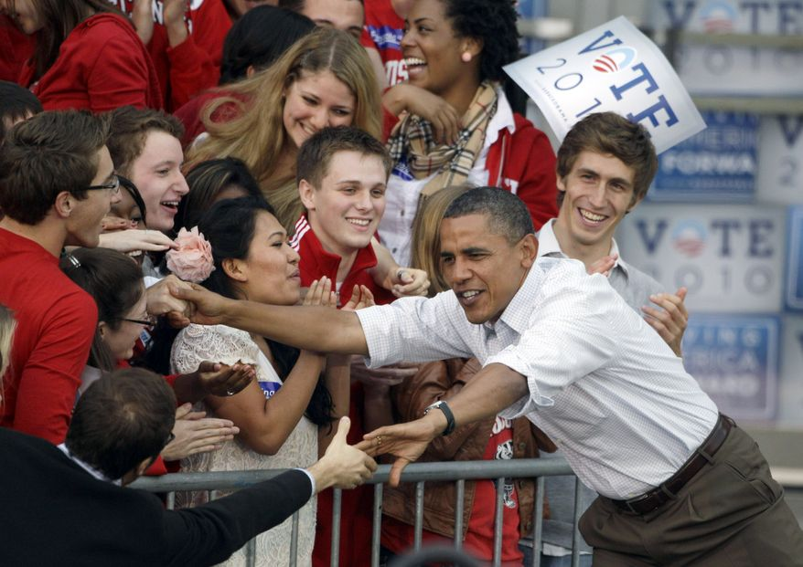 ** FILE ** In this Sept. 28, 2010, photo, President Obama shakes hands as he arrives at a rally on the University of Wisconsin campus in Madison, Wis. (AP Photo)