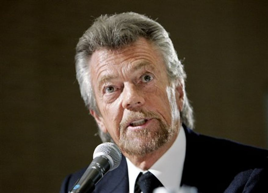 FILE - In this Oct. 3, 2006 file photo, producer and writer Stephen J. Cannell talks about the concentration of media ownership in the hands of a few large corporations at a hearing held by the Federal Communications Commission in Los Angeles. (AP Photo/Reed Saxon, file)