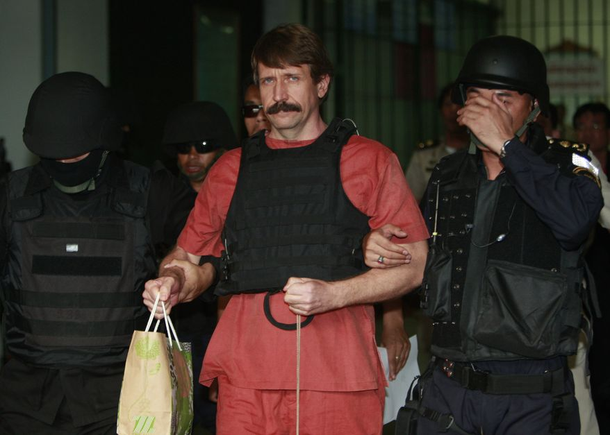 With tight security and the flak jacket on, Viktor Bout, center, a suspected Russian arms dealer, leaves the criminal court in Bangkok, Thailand Monday, Oct. 4, 2010. (AP Photo/Apichart Weerawong)