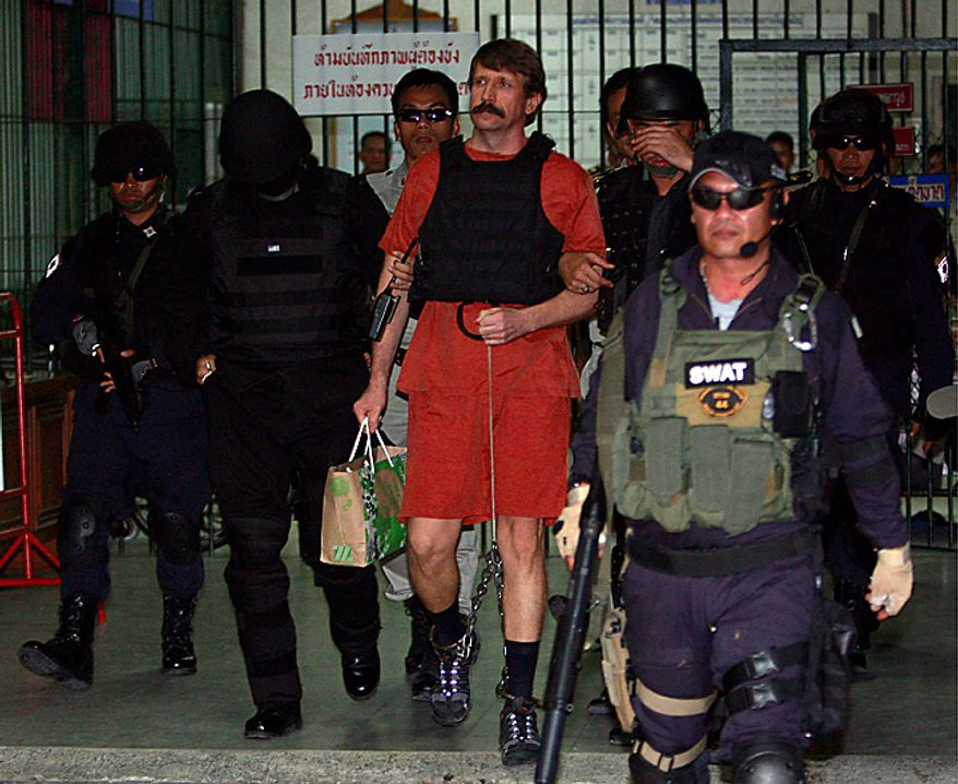 With tight security and the flak jacket on, Viktor Bout, center, a suspected Russian arms dealer, leaves the criminal court in Bangkok, Thailand Monday, Oct. 4, 2010. The Thai court dismissed a request to drop new charges against Bout, a move that means more delays to his long-awaited extradition to the United States. (AP Photo/Apichart Weerawong)