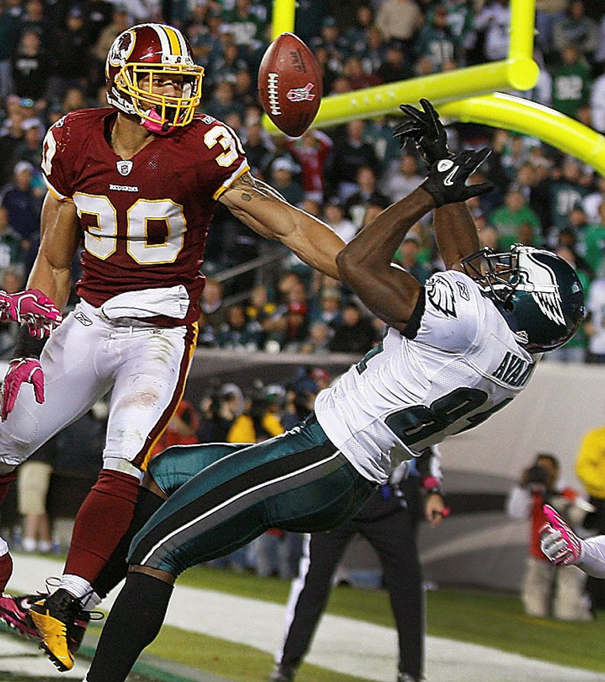 Washington Redskins safety LaRon Landry breaks up a pass intended for Philadelphia Eagles wide receiver Jason Avant in the closing seconds of an NFL football game in Philadelphia, Sunday, Oct. 3, 2010. Washington defeated Philadelphia 17-12. (AP Photo/Mel Evans)