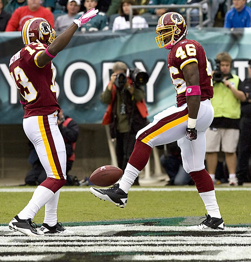 Washington Redskins running back Ryan Torain celebrates his touchdown with teammate Anthony Armstrong with a little kick ball during first quarter Philadelphia Eagles-Washington Redskins game action in Philadelphia at Lincoln Financial Field October 3, 2010.  Washington defeated Philadelphia 17-12. UPI/John Anderson