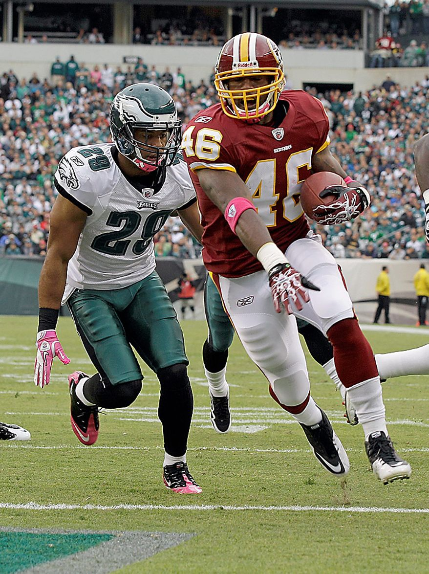 Washington Redskins running back Ryan Torain carries the ball across the goal line for a touchdown as Philadelphia Eagles safety Nate Allen pursues him during the first half of an NFL football game in Philadelphia, Sunday, Oct. 3, 2010. (AP Photo/Rob Carr)