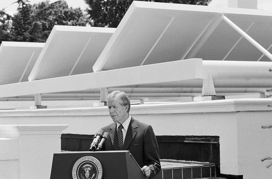 President Carter, shown here in 1979, speaks against a backdrop of solar panels at the White House. Activists used one of Mr. Carter's panels to help persuade President Obama to set an example by powering his residence with solar energy. (Associated Press)