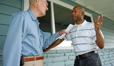 STUMPING: Ryan L. Frazier (right), GOP candidate in Colorado's 7th Congressional District, chats with Andrew Bryce in Wheat Ridge, Colo. Minorities are running strongly as Republicans. (Associated Press)
