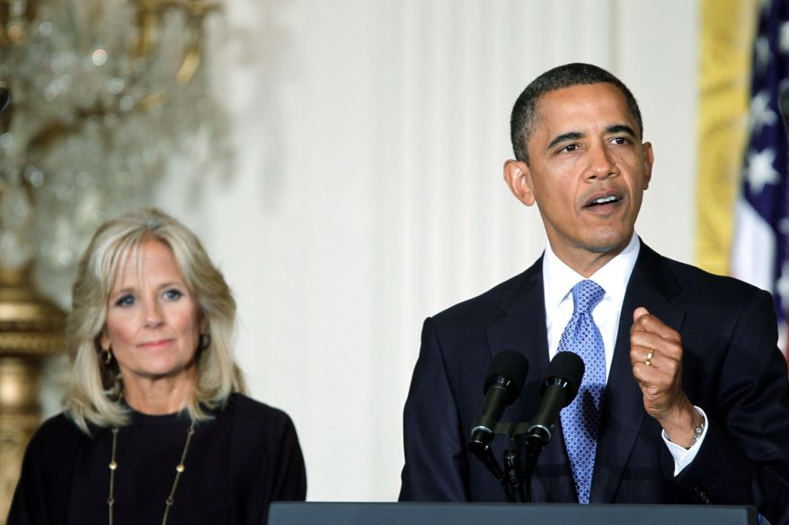 President Obama is accompanied by Jill Biden, wife of Vice President Joseph R. Biden Jr., at a White House summit where he announced a plan to link community colleges with potential employers. (Associated Press)