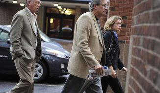 Dr. William Petit Jr., center, arrives at Superior Court in New Haven, Conn., on Tuesday, Oct. 5, 2010. A Connecticut jury found a man guilty in the home invasion killings of Petit's wife and two daughters. (AP Photo/Jessica Hill)