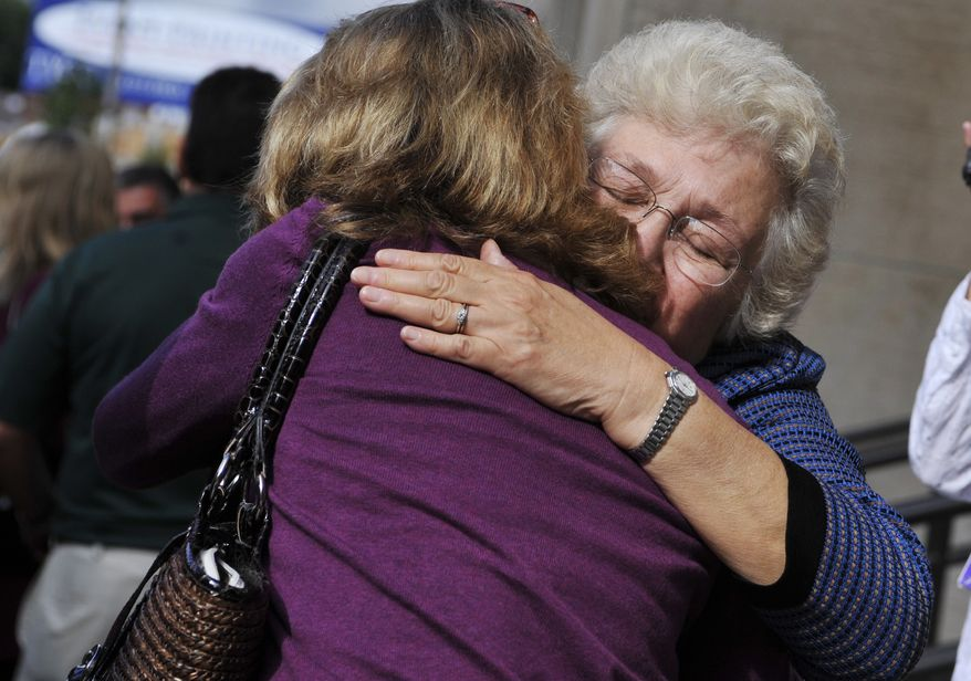 Hanna Chapman, left, sister of Dr. William Petit Jr., and mother Barbara Petit embrace after the first day of the trial of Steven Hayes at Superior Court in New Haven, Conn., on Monday, Sept. 13, 2010. A jury convicted Hayes in the 2007 home invasion and killings on Tuesday, Oct. 5, 2010.. (AP Photo/Jessica Hill)