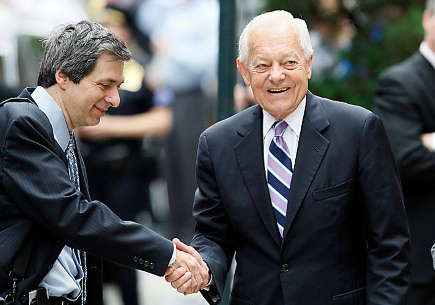 ** FILE ** CBS newsman Bob Schieffer (right) shakes hands with CNN's Howard Kurtz as they arrive for Walter Cronkite's funeral at St. Bartholomew's Church on Park Avenue in New York on Thursday, July 23, 2009. (AP Photo/Kathy Willens)
