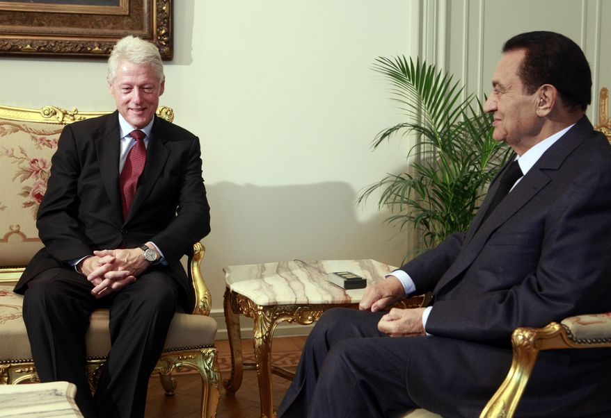 Former President Bill Clinton (left) meets with Egyptian President Hosni Mubarak at the Presidential Palace in Cairo on Tuesday, Oct. 5, 2010. (AP Photo/Amr Nabil)