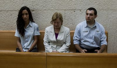 Irish Nobel peace laureate Mairead Corrigan Maguire (center) appears at the Israeli Supreme Court in Jerusalem, Monday Oct. 4, 2010, a day before she was deported. Ms. Maguire is under a 10-year ban from entering Israel because of her attempt to breach the Gaza naval blockade aboard a vessel in June. (AP Photo/Bernat Armangue)