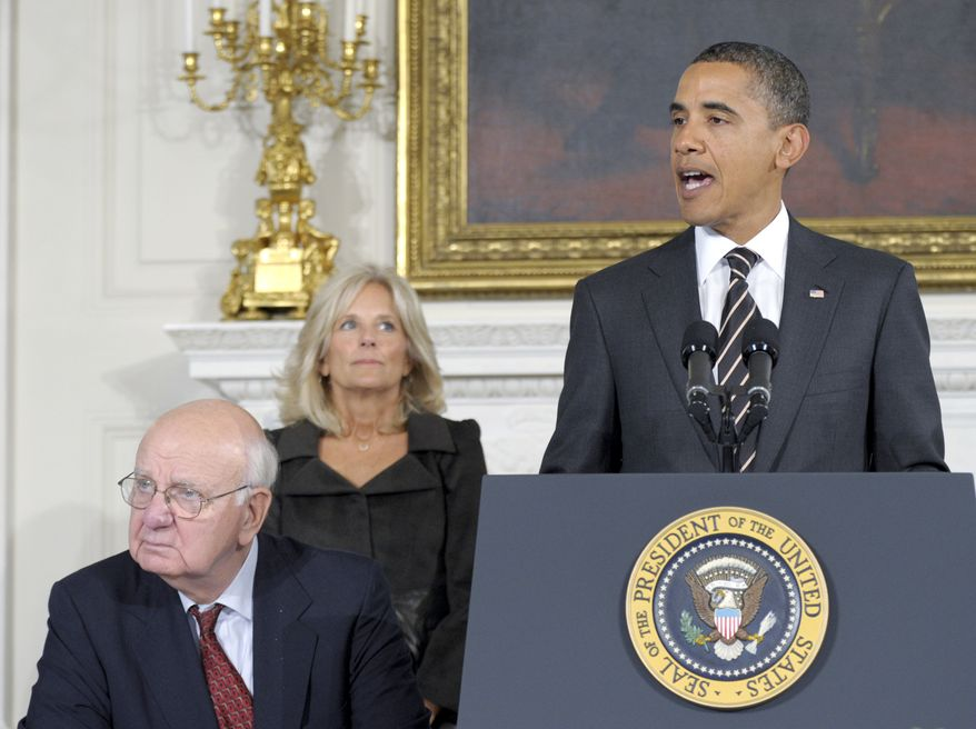 President Obama, accompanied by Paul Volcker (left), chairman of the President's Economic Recovery Advisory Board, and Jill Biden, wife of Vice President Joseph R. Biden Jr., addresses the board on Monday, Oct. 4, 2010, in the State Dining Room of the White House in Washington. (AP Photo/Susan Walsh)