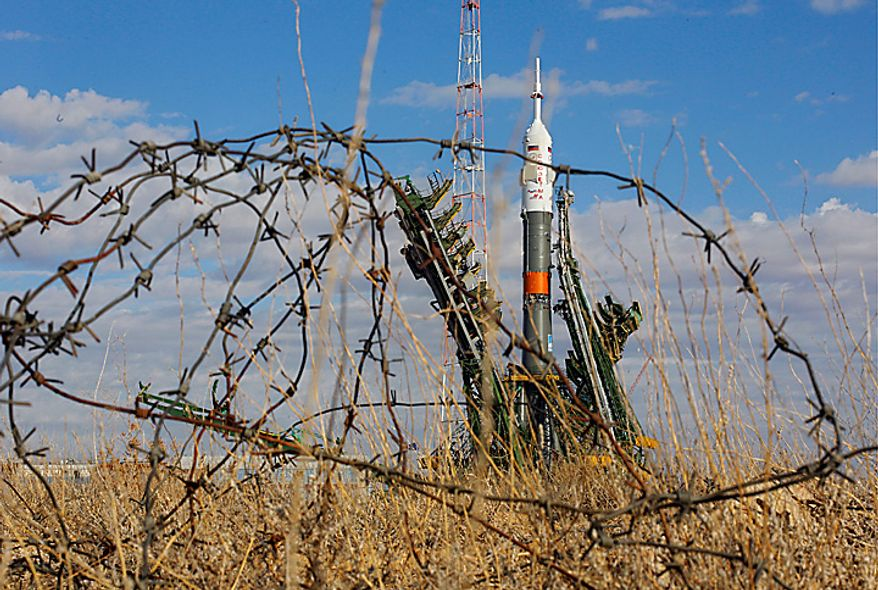 The Russian Soyuz TMA-01M space ship that will carry new crew to the international space station seen at the launch pad at the Russian leased Baikonur cosmodrome, Kazakhstan, Tuesday, Oct. 5, 2010. Start of the new Soyuz mission is scheduled on Friday, Oct. 8. (AP Photo/Dmitry Lovetsky)