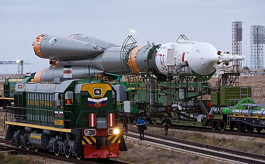 The Russian Soyuz TMA-01M space ship that will carry new crew to the international space station is transported from hangar to the launch pad at the Russian leased Baikonur cosmodrome, Kazakhstan, Tuesday, Oct. 5, 2010. Start of the new Soyuz mission is scheduled on Friday, Oct. 8. (AP Photo/Shamil Zhumatov, Pool)
