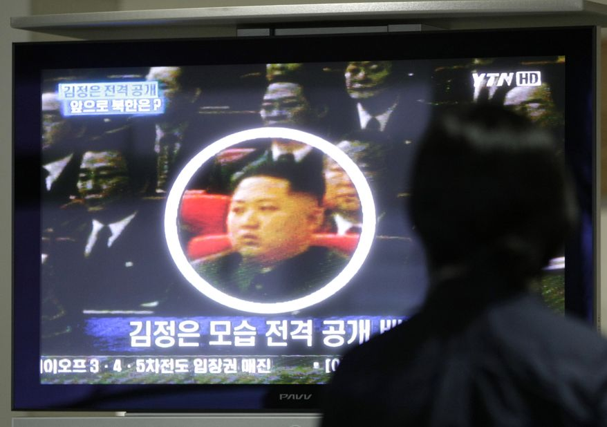 In this Oct. 1, 2010, file photo, a South Korean worker watches a TV news program showing North Korean leader Kim Jong-il's third son Kim Jong-un as she waits to head to the North Korean city of Kaesong at the customs, immigration and quarantine office for North Korea near the Demilitarized Zone (DMZ) of Panmunjom in Paju, South Korea. (AP Photo/Ahn Young-joon, File)