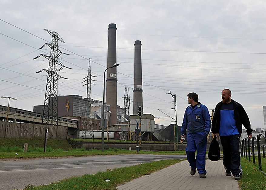 Aluminium workers leave the Ajkai Timfoldgyar plant after the Hungarian authorities suspended its licence in the town of Ajka, Hungary, Tuesday, Oct. 5, 2010. A third person has died in flooding caused by the rupture of a red sludge reservoir at an alumina plant in western Hungary, rescue services said Tuesday. Six people were missing and 120 injured in what officials said was an ecological disaster. The government declared a state of emergency in three counties affected by the flooding. (AP Photo/Bela Szandelszky)