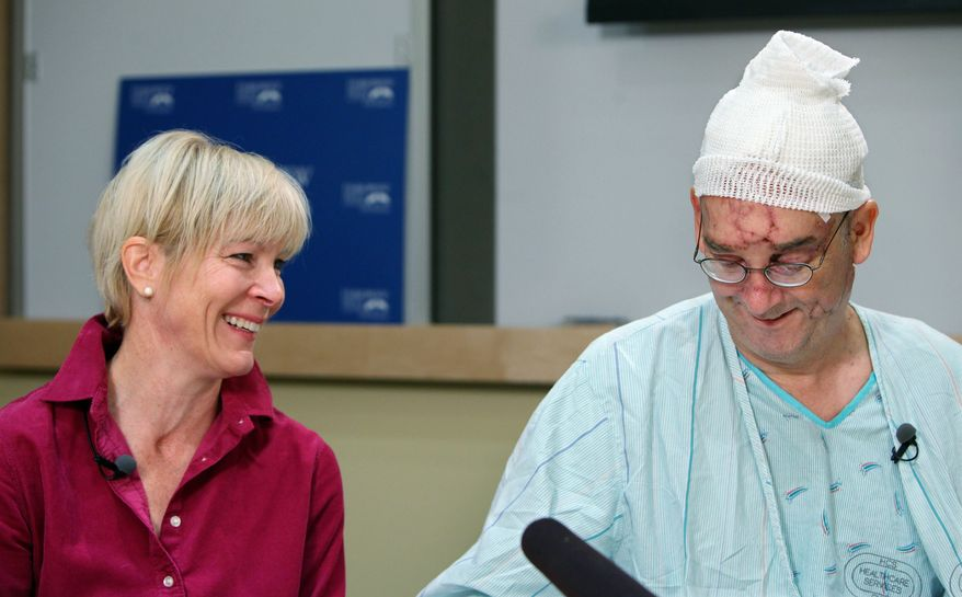 Bellevue, Wash., City Council member John Chelminiak and his wife, Lynn Semler, share a light moment Wednesday during an otherwise harrowing news conference about surviving a bear attack. (Associated Press)