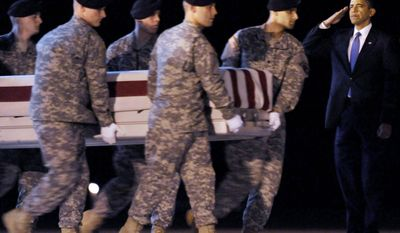 President Obama salutes in October 2009 at Dover Air Force Base, Del., as a team carries the transfer case containing the remains of Army Sgt. Dale R. Griffin of Terre Haute, Ind., who died in Afghanistan. Impatience and uncertainty are rife on all sides on the war's ninth anniversary. (Associated Press)