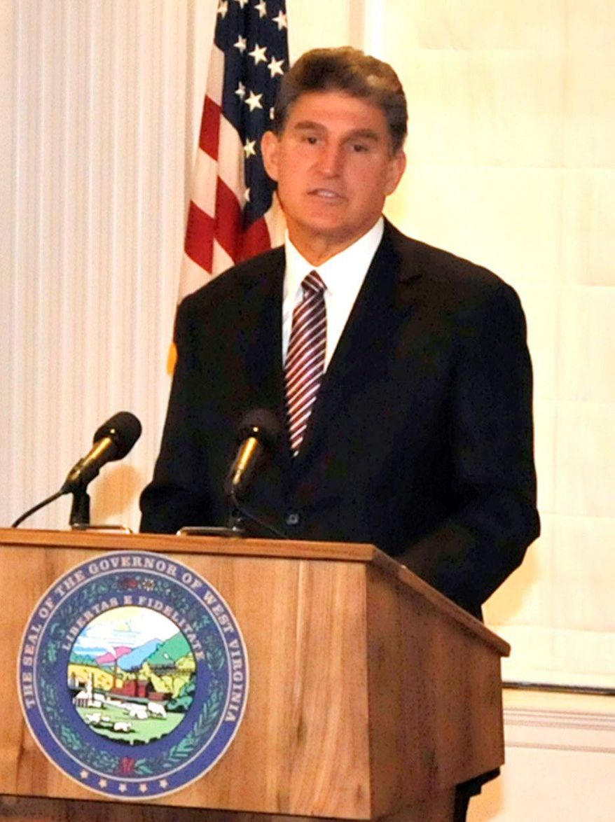 ASSOCIATED PRESS West Virginia Gov. Joe Manchin announces a lawsuit Wednesday challenging EPA regulations.