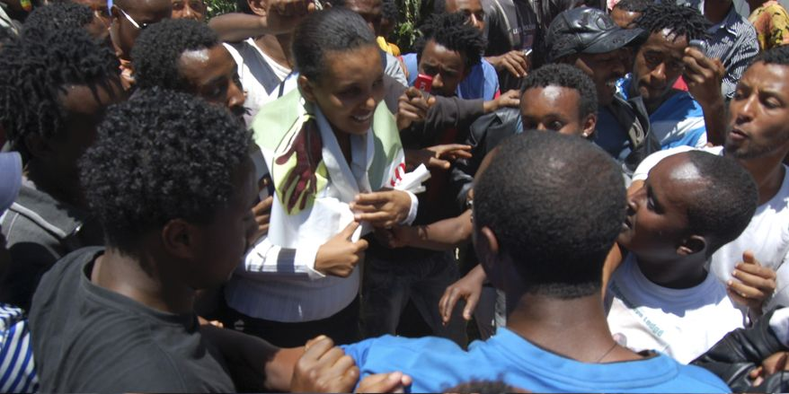 Prominent Opposition figure Birtukan Mideksa, middle in green jacket, is being greeted by hundreds of her supporters shortly after her release in Addis Ababa, Ethiopia, Wednesday, Oct.6, 2010. (AP Photo/Samson Haileyesus)