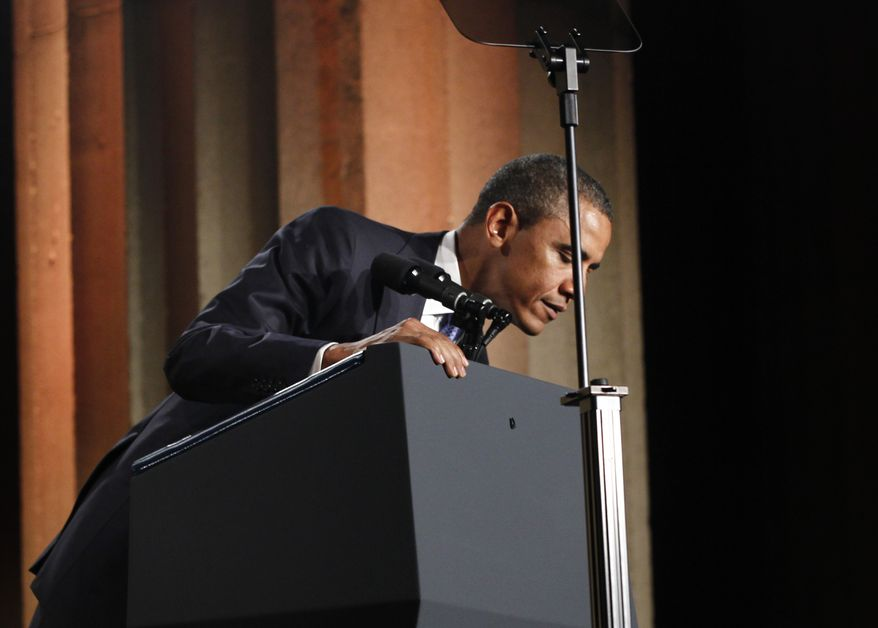 President Obama looks over his podium after the presidential seal fell off of it while he was speaking at Fortune's Most Powerful Women Summit in Washington, Tuesday, Oct. 5, 2010. (AP Photo/Charles Dharapak)