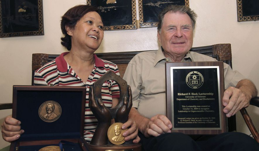 American Richard Heck, 79, and his Filipino wife, Socorro, display some of his awards during an interview with the Associated Press at their residence at Manila's Quezon city in the Philippines shortly after the Royal Academy of Sciences announced in Sweden he won the 2010 Nobel Prize in Chemistry Wednesday Oct. 6, 2010. (AP Photo/Bullit Marquez)