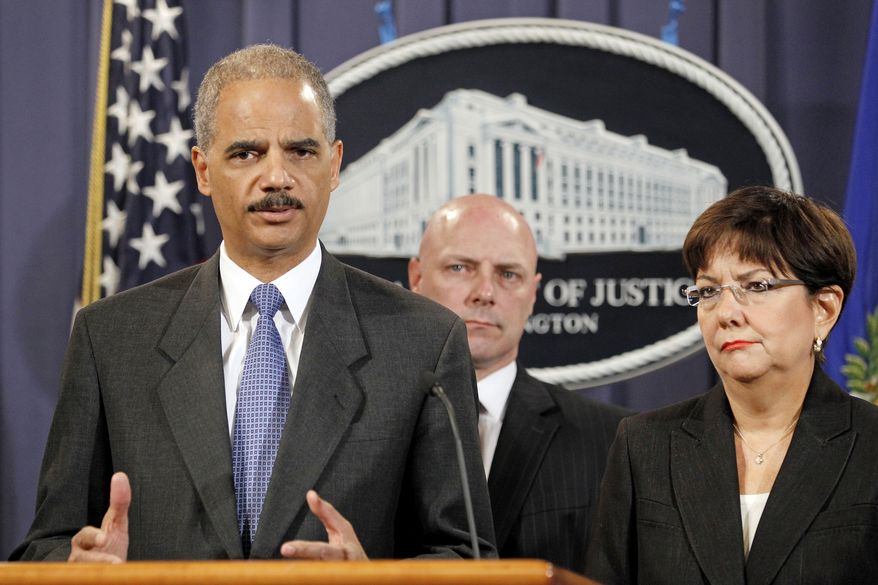 Attorney General Eric H. Holder Jr. (left), accompanied by U.S. Attorney Rosa Emilia Rodriguez-Velez (right) of the District of Puerto Rico and FBI Executive Director Shawn Henry, answers questions during a news conference at the Justice Department in Washington on Wednesday, Oct. 6, 2010. Earlier in the day, FBI agents arrested scores of Puerto Rican police officers for allegedly aiding drug dealers. (AP Photo/Haraz N. Ghanbari)