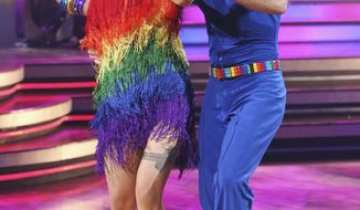 "In this publicity image released by ABC, Margaret Cho, left, and her partner Louis Van Amstel perform on the celebrity dance competition series, ""Dancing With the Stars,"" Monday, Oct. 4, 2010, in Los Angeles. (AP Photo/ABC, Adam Larkey)"