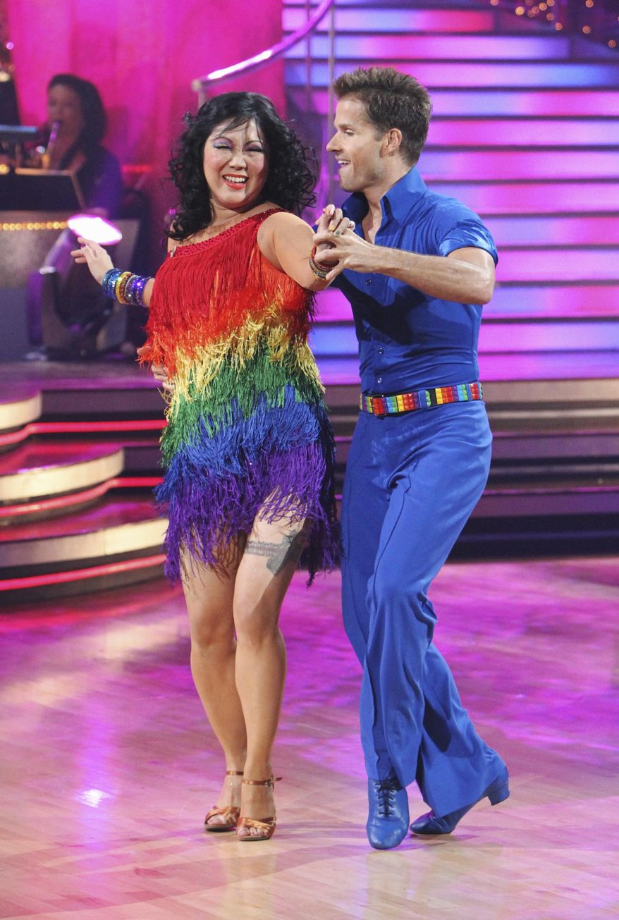 """In this publicity image released by ABC, Margaret Cho, left, and her partner Louis Van Amstel perform on the celebrity dance competition series, """"Dancing With the Stars,"""" Monday, Oct. 4, 2010, in Los Angeles. (AP Photo/ABC, Adam Larkey)"""