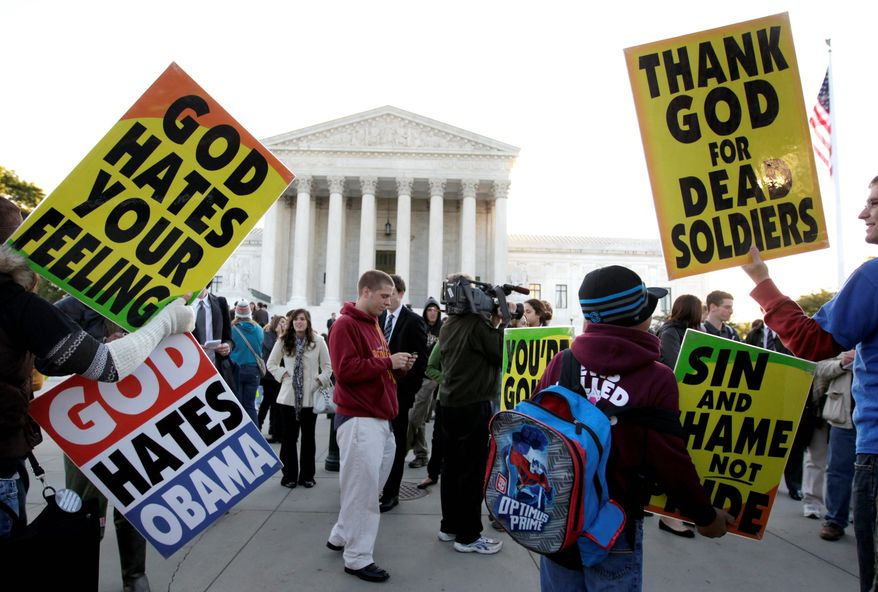 Members of the Westboro Baptist Church picket in front of the U.S. Supreme Court in Washington on Wednesday, Oct. 6, 2010. The court was hearing the free-speech dispute between Albert Snyder of York, Pa., and the Topeka, Kan., church. The case focuses on whether the church has the right to protest at funerals. (Associated Press) ** FILE **