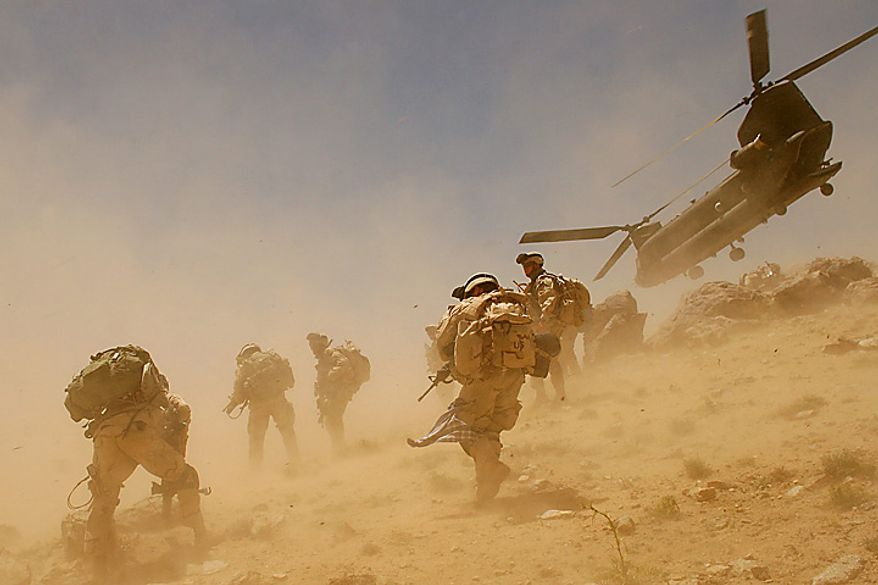 In this Sunday, June 26, 2005 file picture, a CH-47 Chinook helicopter lifts off after dropping off soldiers in the village of Bagh in the Khakeran Valley, Zabul province, Afghanistan. (AP Photo/Tomas Munita, File)