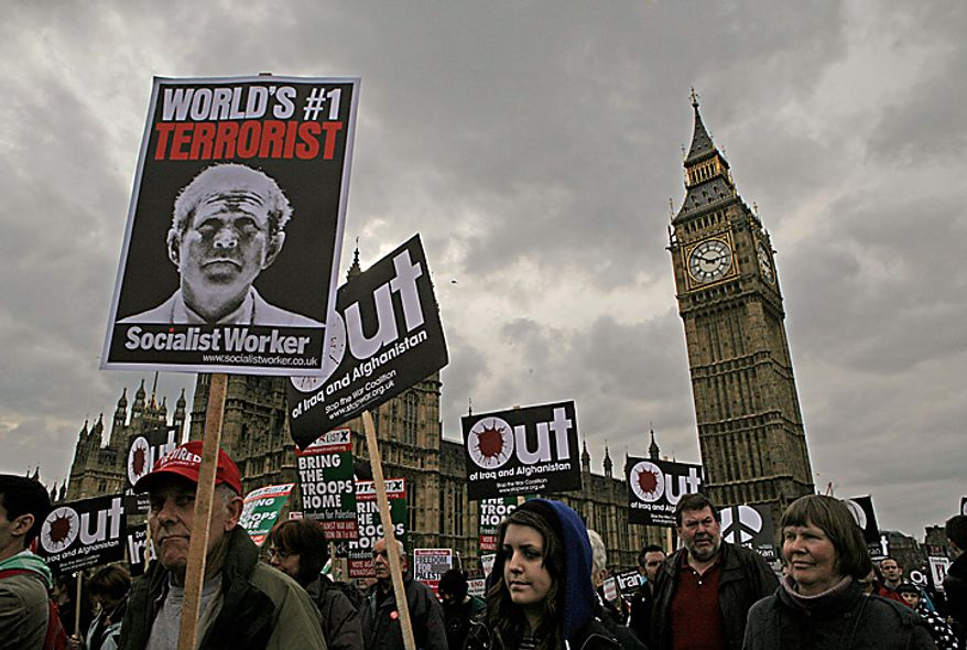 In this Saturday, March 15, 2008 file picture, thousands of anti-war protesters walk past the Houses of Parliament in central London, calling for troops to be pulled out from Iraq and Afghanistan and to mark the fifth anniversary of the invasion of Iraq. (AP Photo/Lefteris Pitarakis, File)