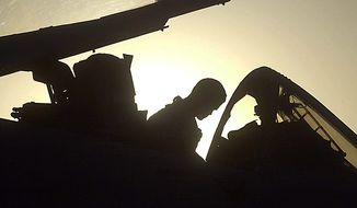 In this Monday, Oct. 7, 2002 file picture, a U.S. Air Force pilot in an A-10 Thunderbolt attack jet returns from a combat mission, in Bagram air base, northeast of Kabul, Afghanistan. (AP Photo/Darko Bandic, File)
