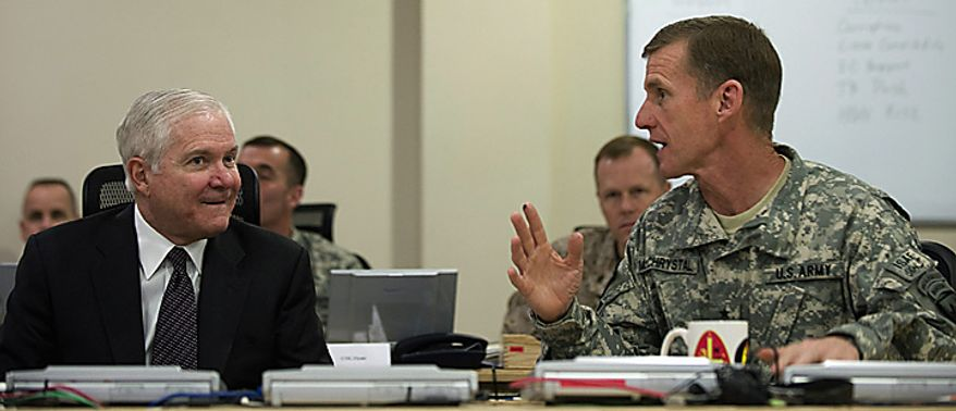 In this Monday March 8, 2010 file picture, U.S. Secretary of Defense Robert Gates, left,  speaks with Commander of U.S. and NATO forces in Afghanistan General Stanley McChrystal during a meeting in Kabul, Afghanistan. (AP Photo/Jim Watson, Pool, File)