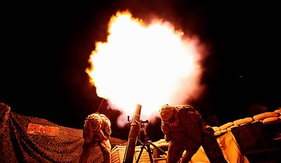 In this Sept. 23, 2009 file photo, soldiers from the U.S. Army's 3rd Battalion, 509th Infantry Regiment (Airborne, based at Fort Richardson, Alaska, fire a 120mm mortar during a fire mission at the combat outpost Zerok in East Paktika province in Afghanistan. (AP Photo/Dima Gavrysh, File)