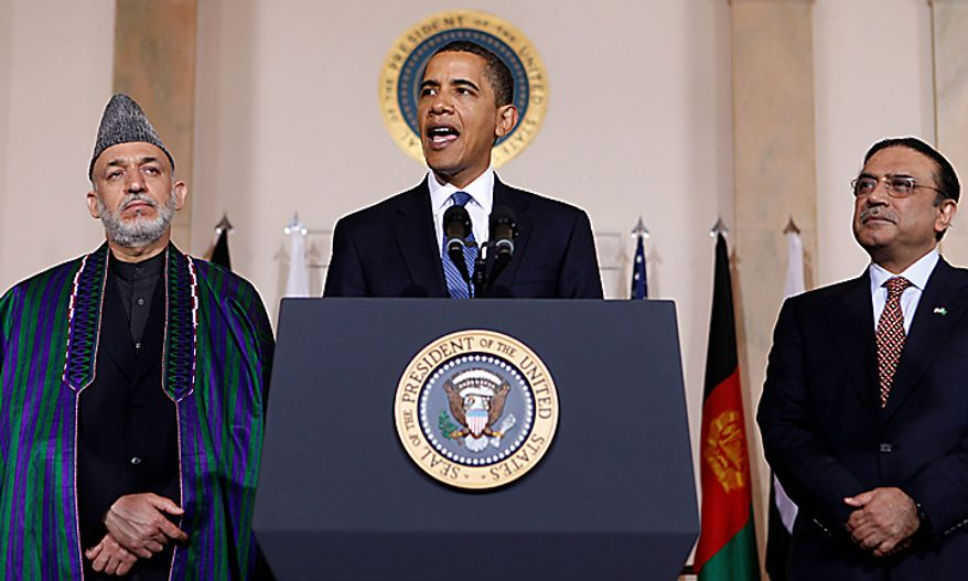 **FILE** In this photo from May 6, 2009, President Obama speaks to reporters after his meeting with Afghanistan's President Hamid Karzai (left) and Pakistani President Asif Ali Zardari in the Grand Foyer of the White House. (Associated Press)