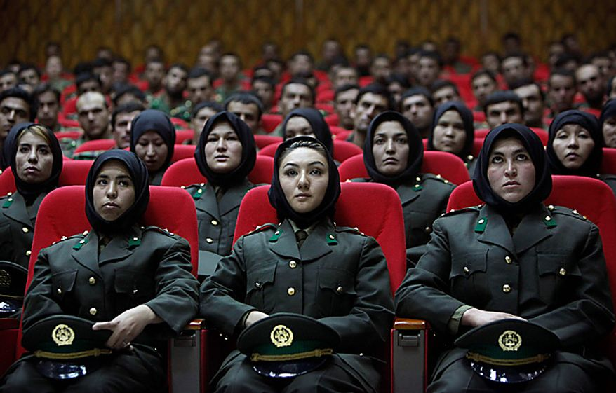 In this Thursday, Sept. 23, 2010 file picture, newly trained female officers of Afghan National Army take front seats as a new group of officers attend their graduation ceremony at National Army's training center in Kabul, Afghanistan. (AP Photo/ Gemunu Amarasinghe, File)