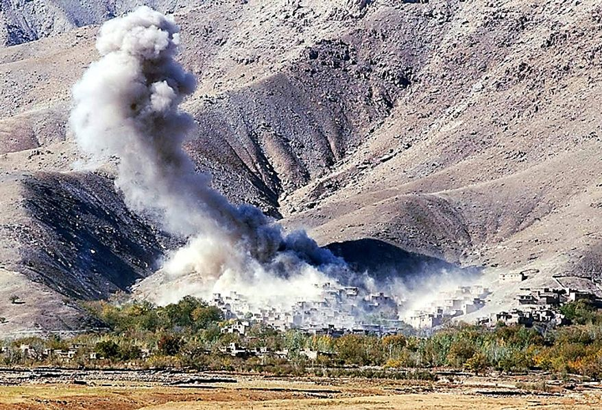 In this Saturday, Nov. 3, 2001 file picture, a plume of smoke rises from the village of Esferghich after two US aircraft released their load of bombs, 50 kilometers (30 miles) from the Afgahn capital of Kabul as a part of the U.S. attempt to help the northern alliance advance toward the capital and other key areas. (AP Photo/Marco Di Lauro, File)