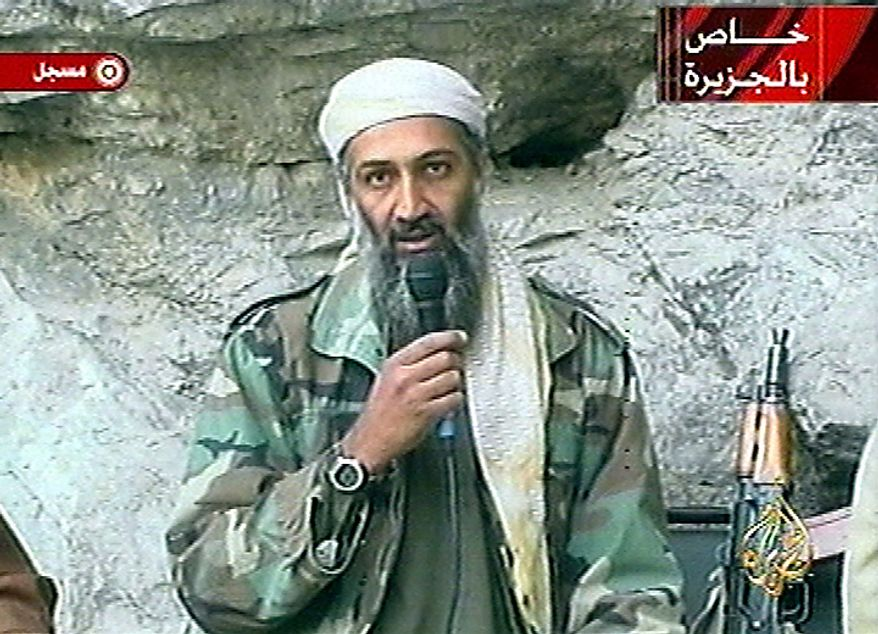 """The image made from video broadcast on Sunday, Oct. 7, 2001 shows Osama bin Laden at an undisclosed location. Graphic at top right reads """"Exclusive to Al-Jazeera."""" At bottom right is the Al-Jazeera television network logo. At top left is """"recorded."""" (AP Photo/Al Jazeera, File)"""