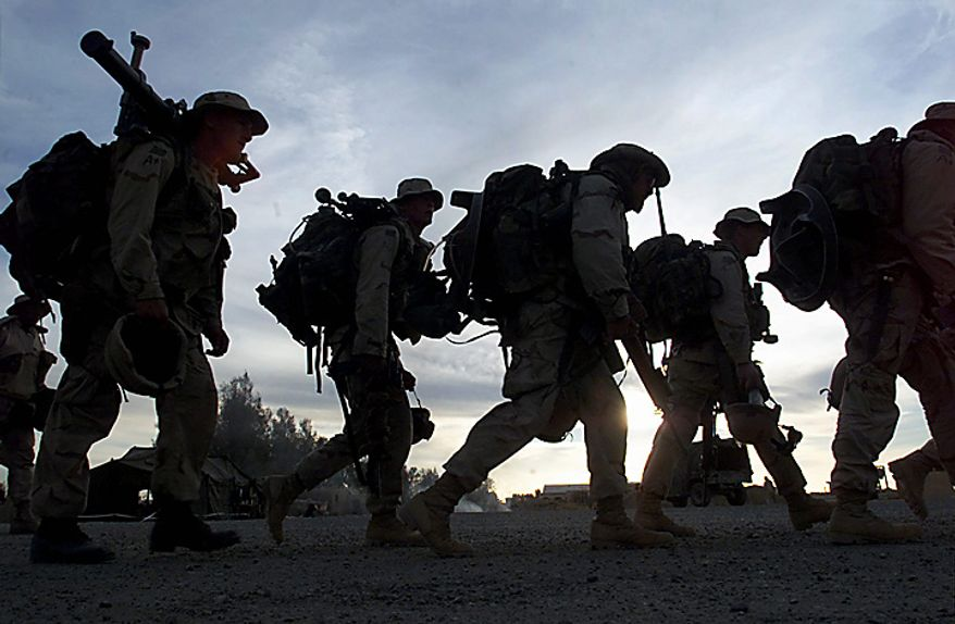 In this Monday, Dec. 31, 2001 file picture, Marines with full battle gear prepare to board transport helicopters at the U.S. military compound at Kandahar airport for a mission to an undisclosed location in Afghanistan. (AP Photo/John Moore, File)