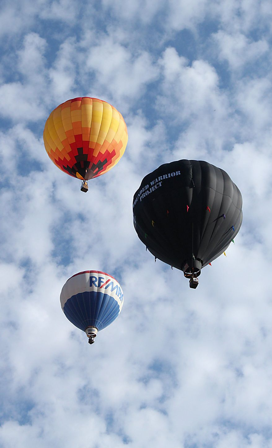 Hot air balloons fill the sky during the Albuquerque International Balloon Fiesta in Albuquerque, N.M., on Saturday, Oct. 2, 2010. Many balloonists participating in the event are hopeful that missing American pilots Richard Abruzzo and Carol Rymer Davis will be found. The pair went missing over the Adriatic Sea on Wednesday during a European gas balloon race. (AP Photo/Susan Montoya Bryan)